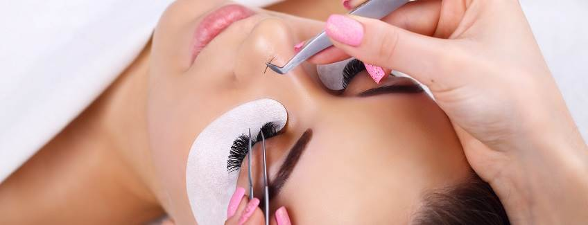 Eyelash extension adhesive application.
